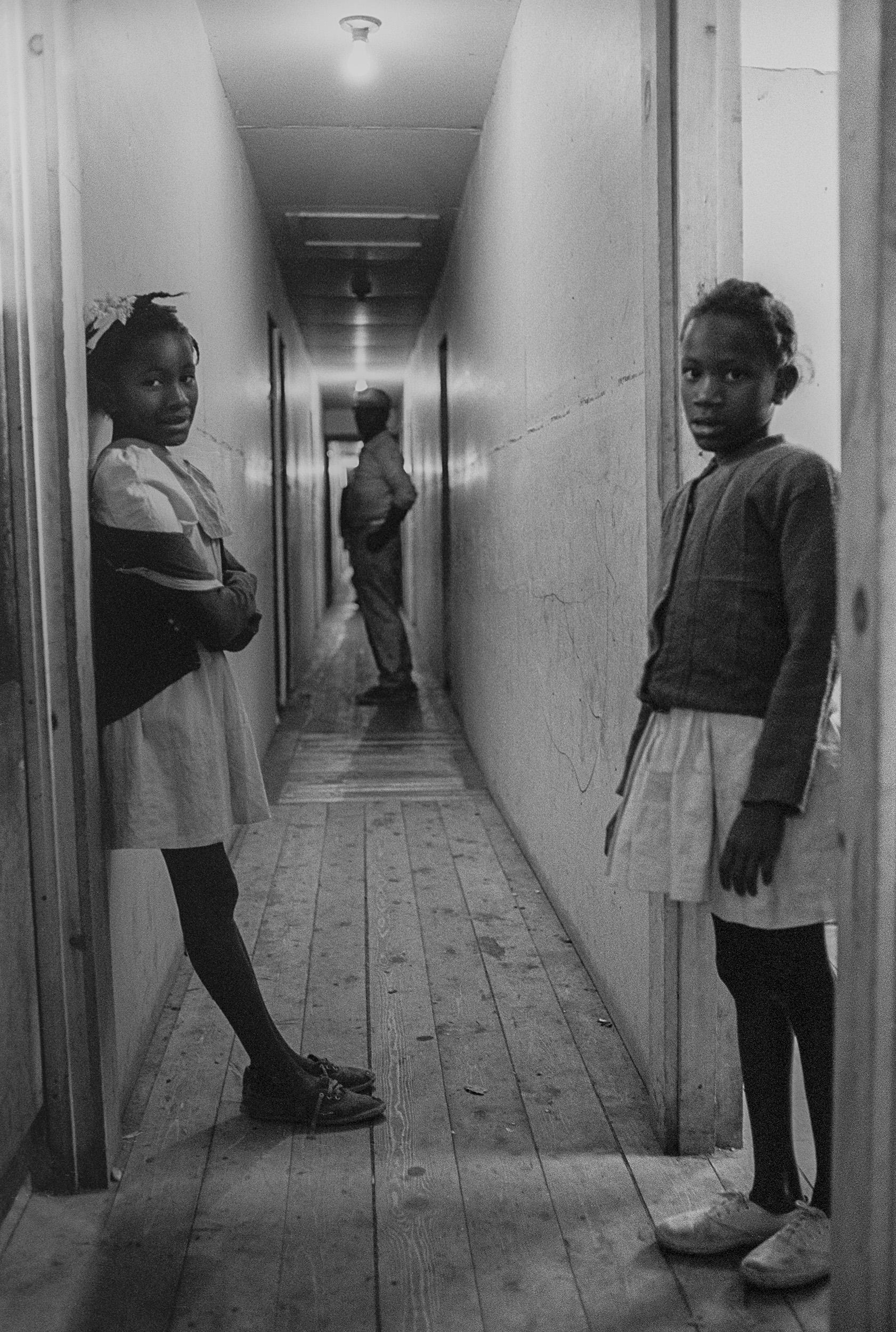 narrow hall 2 girls